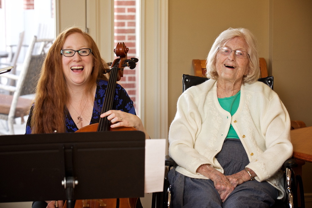 Senior citizen benefits from Signature Symphony music.