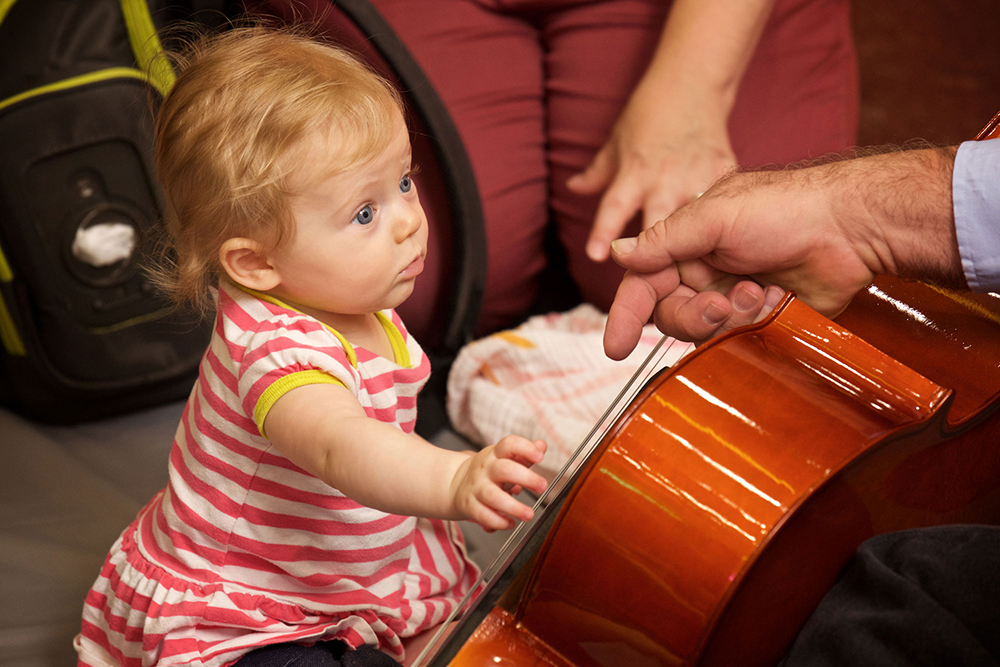 Young patron experiences music at the Seedling Symphony.